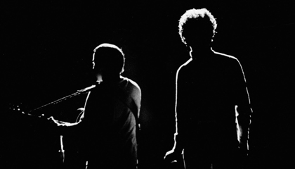 Simon and Garfunkel on stage in silhouette_billboard
